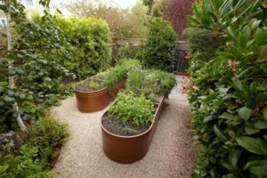 Wide Water Troughs as Raised Garden Beds with Sleek Metallic Color Accent By Gardenista
