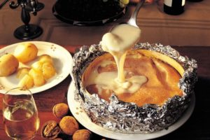 Baked whole Vacherin Mont d'Or with chat potatoes and cornichons – soul-filling culinary