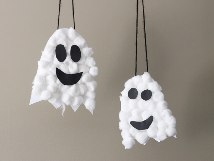 Create Halloween Puffy Ghosts with Construction paper and cotton balls glue