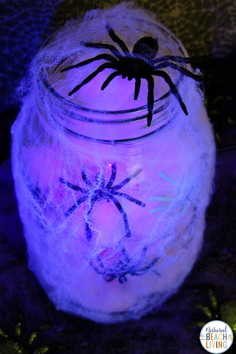 Spooky spider mason jar craft for kids with spiders, glowsticks, and cotton balls
