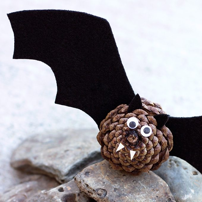 Hot Glue Pinecone and Black felt for Cute and Creepy Halloween Bats for kids
