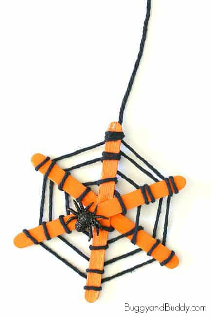 Cute Popsicle Stick Yarn Halloween Spider Web Craft for Toddlers fine Motor Skills