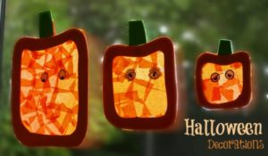Create tissue paper Halloween pumpkin sunlight catchers