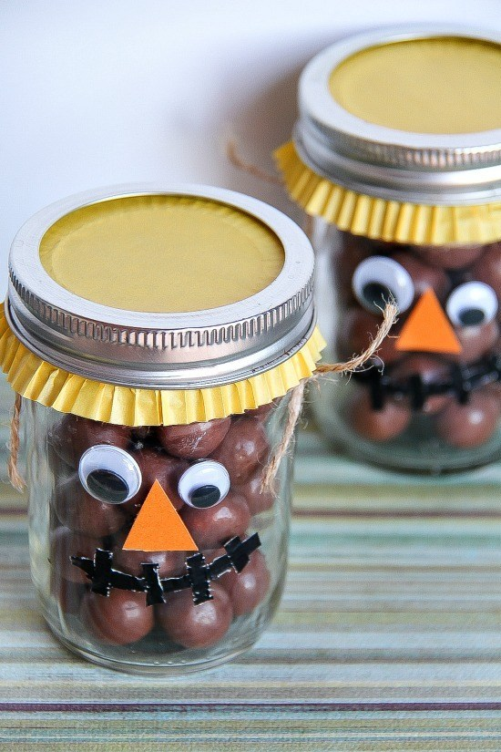 Fill the Halloween Leftover Candies in Mason Jars and Decorate to Make Scarecrow Treat Jars