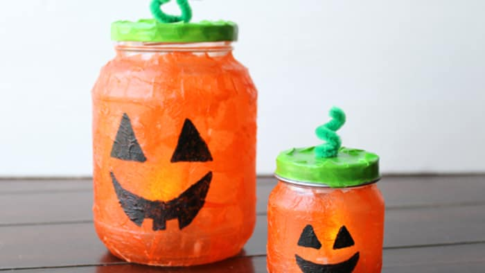 Make Create Halloween Pumpkin Luminaries Craft with Recycled Glass Jars, Mod Podge, Makers, and  ...