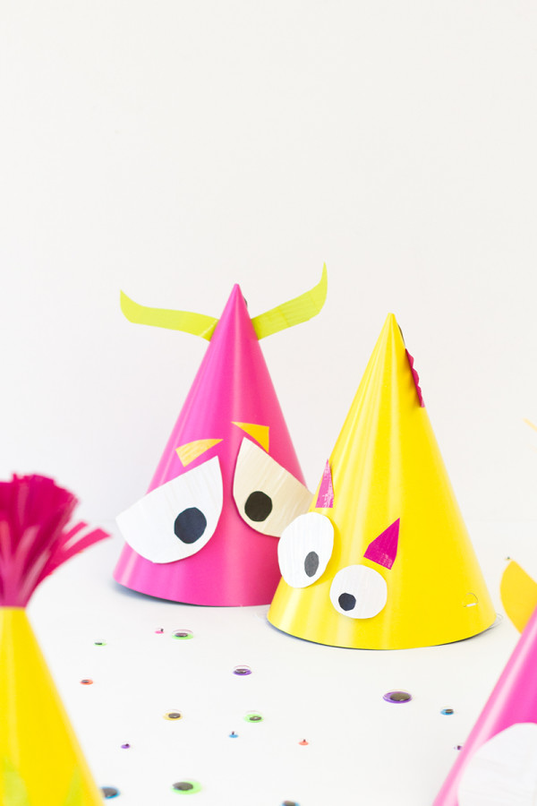 Craft Bright and Colorful Monster Party Hats for this Halloween with Duct tape and Party Hats